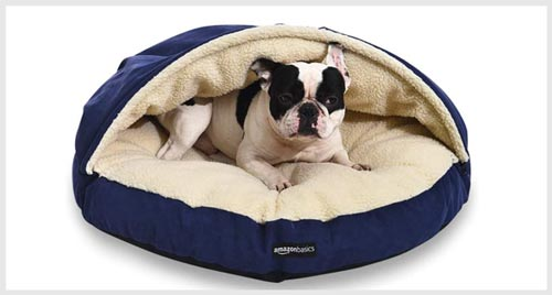 dog lying on a snuggery burrow pet bed